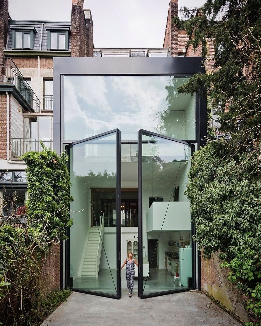 Image of pivot patio doors by @nuprojects.co